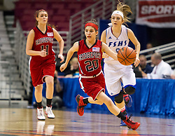 Bridgeport guard Gianina Renzelli (20) dribbles the ball up the floor against Fairmont Senior during a first round game at the Charleston Civic Center.