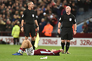 Aston Villa midfielder Jack Grealish (10) lies on the pitch, exhausted during the EFL Sky Bet Championship match between Aston Villa and Nottingham Forest at Villa Park, Birmingham, England on 28 November 2018.