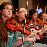 Thomas Wells | BUY at PHOTOS.DJOURNAL.COM<br /> Callie Philips, 15, and the rest of the violin section of the students stand ready to join in with the Tupelo Symphony Orchestra on Friday at the Civic Auditorium.