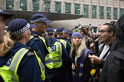 London, UK. 4th November, 2015. Metropolitan Police officers form a cordon around thousands of students and their supporters attending a National Demonstration for a Free Education. The demonstration was organised by the National Campaign Against Fees and Cuts (NCAFC) in protest against tuition fees and the Government's plans to axe maintenance grants with effect from 2016.