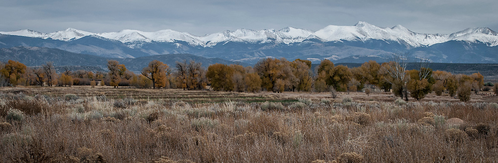 Photograph of Southern Colorado's snow-capped Culebra section of the Sangre de Cristo Mountain range.<br /> <br /> AVAILABLE AS:<br /> <br /> Size 12&rdquo; x 36&rdquo; (30.48cm x 91.44cm approx)*<br /> Edition of ONLY 100 at this size.<br /> US$450 + shipping<br /> <br /> Hand printed in Taos, New Mexico, USA by Taos Print and Photography Services using archival inks and fine art paper. signed and numbered by hand.<br /> <br /> Contact jim@jimodonnellphotography.com to order