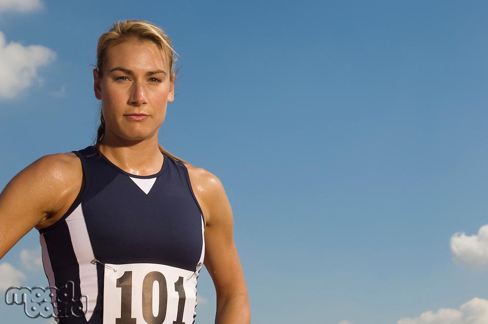 Female track athlete standing