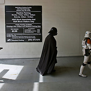 """Costumed members of the 70th Explorers Garrison from the six """"Star Wars"""" movies walked back to their cars at the Power & Light District on Sunday morning for the March for Babies Walk downtown to raise money for the March of Dimes mission. The characters, Boba Fett, left, Darth Vader, center and an Imperial stormtrooper, right, supported the walk with their donated appearance for the children at the walk."""