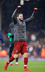 LONDON, ENGLAND - Sunday, March 17, 2019: Liverpool's goalkeeper Adam Lallana celebrates 2-1 victory after the FA Premier League match between Fulham FC and Liverpool FC at Craven Cottage. (Pic by David Rawcliffe/Propaganda)
