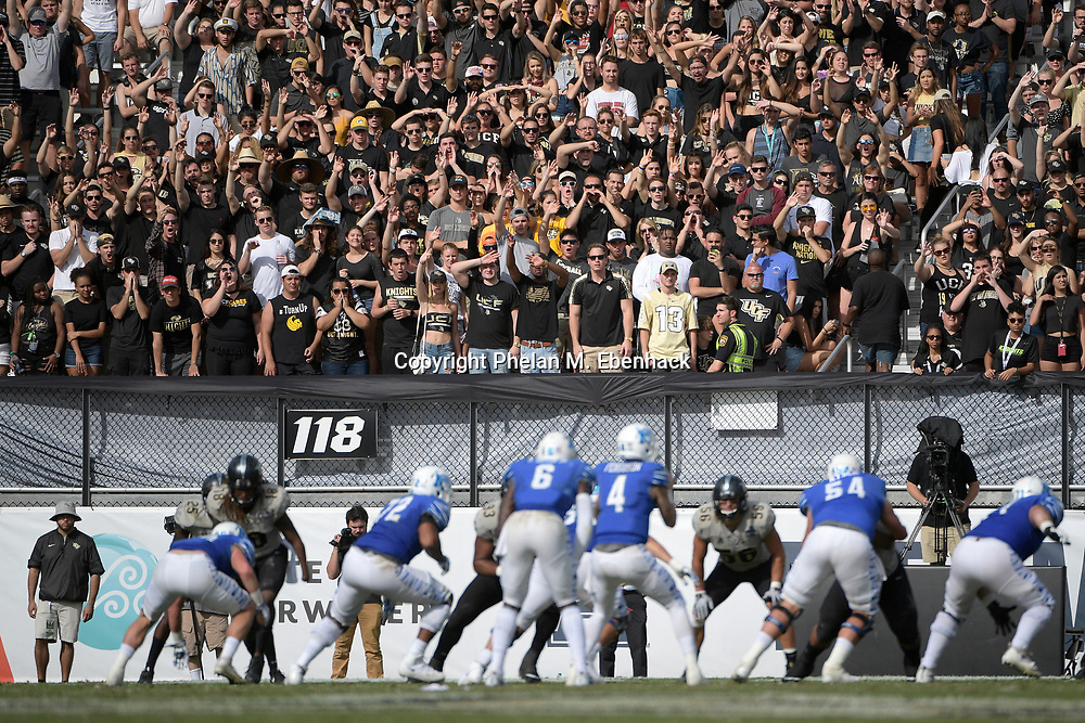 Central Florida fans watch from the stands during the first half of the American Athletic Conference championship NCAA college football game against Memphis Saturday, Dec. 2, 2017, in Orlando, Fla. (Photo by Phelan M. Ebenhack)