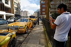 © Licensed to London News Pictures. 30/03/2016. London, UK. A fleet of supercars covered in gold chrome wrap parked in Knightsbridge, London on Wednesday, 30 March 2016. Cars believed to be owned by a tourist from Saudi Arabia. Photo credit: Tolga Akmen/LNP