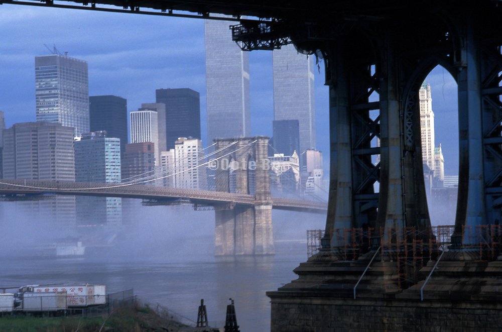view of downtown new york city from under the Manhattan Bridge