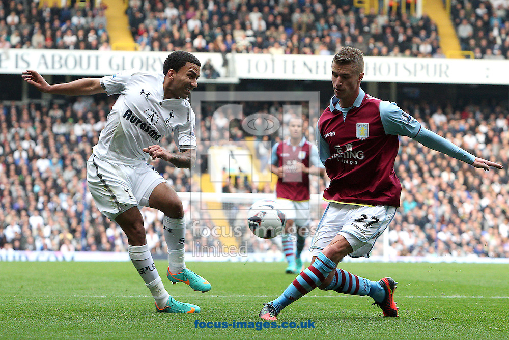 Picture by Paul Terry/Focus Images Ltd +44 7545 642257.07/10/2012.Aaron Lennon of Tottenham Hotspur has his cross blocked by Joe Bennett of Aston Villa during the Barclays Premier League match at White Hart Lane, London.