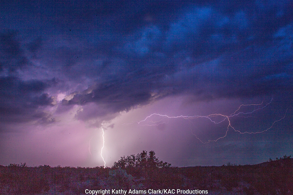Lightning during thunderstorm after sunset in Big Bend National Park, Texas in summer.