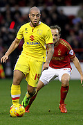 MK Dons midfielder Samir Carruthers on the attack during the Sky Bet Championship match between Nottingham Forest and Milton Keynes Dons at the City Ground, Nottingham, England on 19 December 2015. Photo by Aaron Lupton.