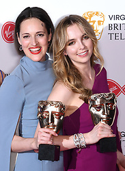 Phoebe Waller-Bridge and Jodie Comer in the press room during the Virgin Media BAFTA TV awards, held at the Royal Festival Hall in London. Photo credit should read: Doug Peters/EMPICS