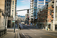 Peal District in Portland, OR on a sunny morning looking towards 9th Ave from Broadway Bridge