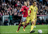 FOOTBALL: Vlad Chiricheş (Romania) is followed by Christian Eriksen (Denmark) during the World Cup 2018 UEFA Qualifier Group E match between Denmark and Romania at Parken Stadium on October 8, 2017 in Copenhagen, Denmark. Photo by: Claus Birch / ClausBirch.dk.
