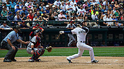 Seattle Mariner 2nd Baseman, Nick Franklin hits the first of two homeruns during a match up against the Minnesota Twins. Photo by John Lill