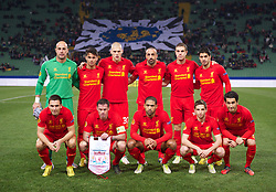 UDINE, ITALY - Thursday, December 6, 2012: Liverpool's players line up for a team group photograph before the final UEFA Europa League Group A match against Udinese Calcio at the Stadio Friuli. Back row L-R: goalkeeper Jose Reina, 'Suso' Jesus Joaquin Fernandez Saenz De La Torre, Martin Skrtel, Jose Enrique, Jordan Henderson, Luis Alberto Suarez Diaz. Front row L-R: Stewart Downing, Jamie Carragher, Glen Johnson, Joe Allen, Nuri Sahin. (Pic by David Rawcliffe/Propaganda)