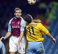 Fotball<br /> Carling Cup England<br /> 03.12.2003<br /> Aston Villa v Crystal Palace<br /> Olof Mellberg - Villa<br /> Neil Shipperley - Palace<br /> Foto: Anders Hoven, Digitalsport