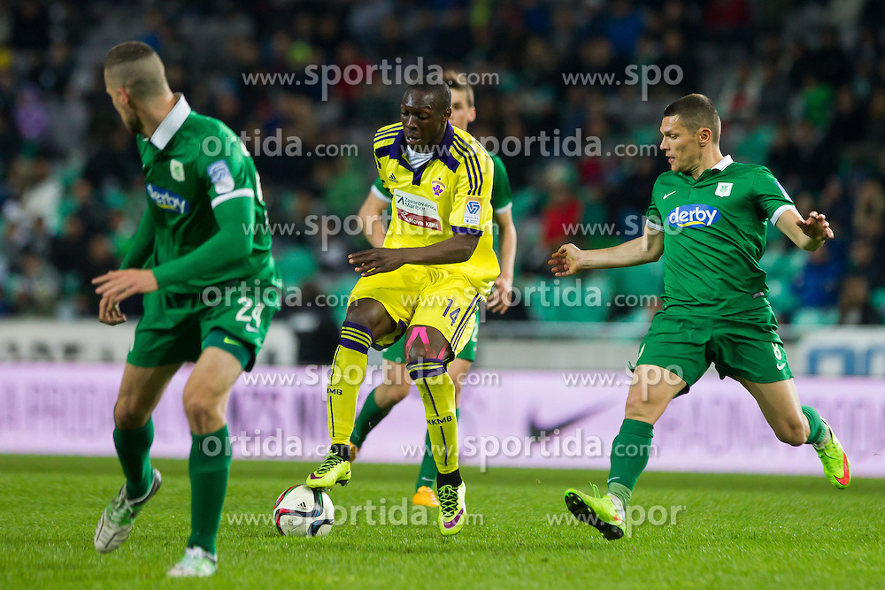 Jean Philippe Mendy #14 of Maribor, Kenan Bajric #24 of Olimpija and Darijan Matic #8 of Olimpija during football match between NK Olimpija Ljubljana and NK Maribor in Round #26 of Prva liga Telekom Slovenije 2014/15, on April 8, 2015 in SRC Stozice, Ljubljana, Slovenia. Photo by Ziga Zupan / Sportida