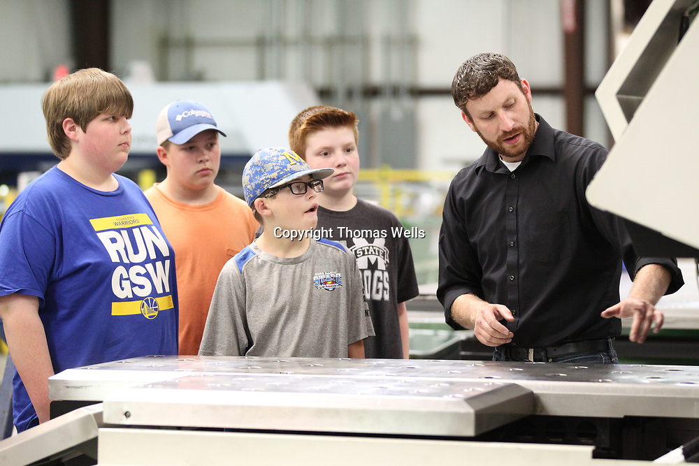 Anthony Youngblood shows shows campers with Itawamba Community College's Tek2Go program how some how Hawkeye Industries machinery works during a tour and hands on lesson Wednesday morning.