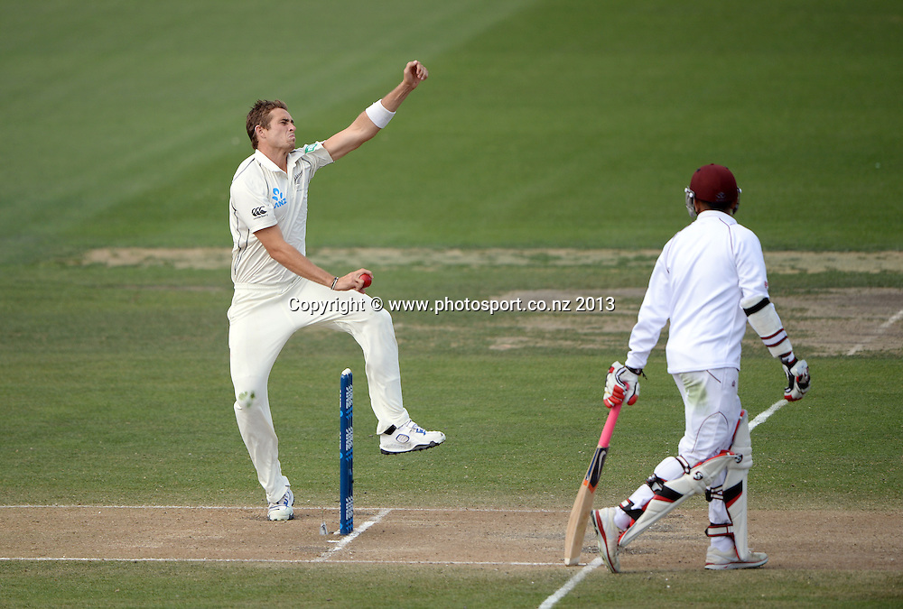 Tim Southee bowling on Day 3 of the 3rd cricket test match of the ANZ Test Series. New Zealand Black Caps v West Indies at Seddon Park in Hamilton. Saturday 21 December 2013. Photo: Andrew Cornaga / www.Photosport.co.nz