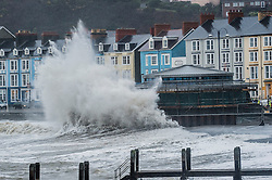 © London News Pictures. 30/11/2015. Aberystwyth, UK.<br /> For the third day in succession Storm Clodaghís gale  force winds and high tides bring huge waves crashing into the sea defences and the promenade in Aberystwyth on the west Wales coast. Photo credit: Keith Morris/LNP