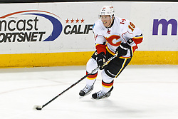 Jan 17, 2012; San Jose, CA, USA; Calgary Flames center Blair Jones (19) skates with the puck against the San Jose Sharks during the second period at HP Pavilion. San Jose defeated Calgary 2-1 in shootouts. Mandatory Credit: Jason O. Watson-US PRESSWIRE