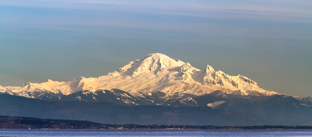 View of Mount Baker across Boundary Bay from Boundary Bay Regional Park in Delta, British Columbia, Canada