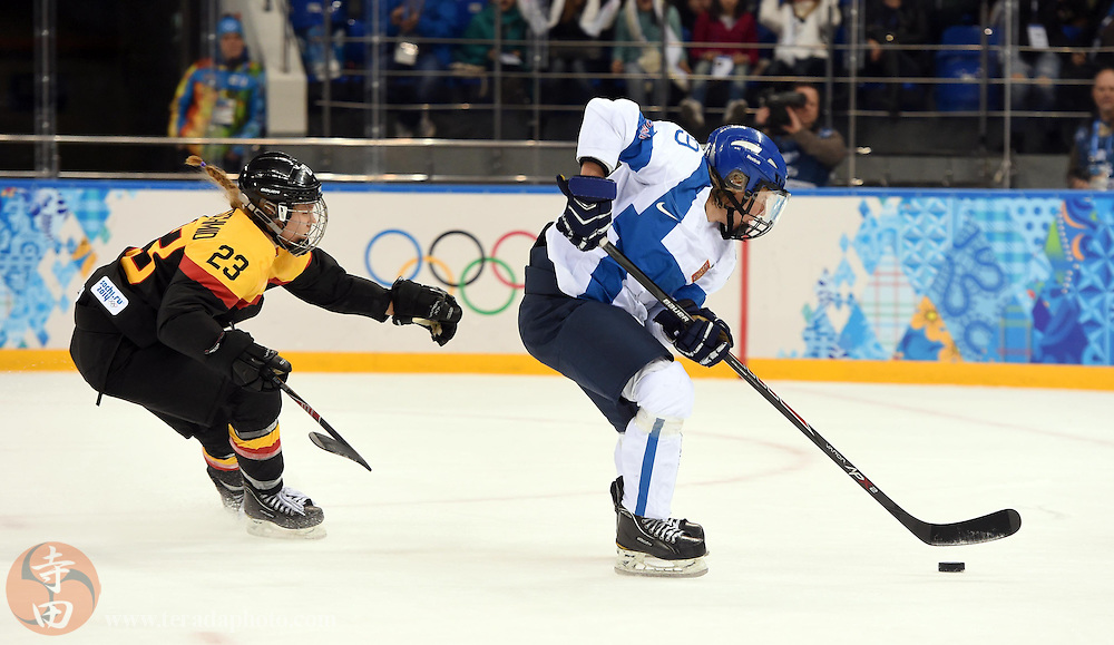 Feb 16, 2014; Sochi, RUSSIA; Finland forward Karoliina Rantamaki (29) skates past Germany defenseman Tanja Eisenschmid (23) in the women's ice hockey classifications round during the Sochi 2014 Olympic Winter Games at Shayba Arena.