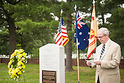 CK Gailey speaks during a ceremony marking 71th anniversary of a crash that killed 40 Army Air Corps members at Bakers Creek, Australia at Joint Base Myer-Henderson Hall in Arlington, Va. on June 13, 2014. Photo by Kris Connor