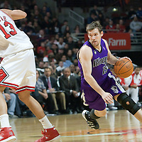21 December 2009: Sacramento Kings guard Beno Udrih drives past Chicago Bulls center Joakim Noah during the Sacramento Kings 102-98 victory over the Chicago Bulls at the United Center, in Chicago, Illinois, USA.