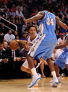 Oct. 22 2010; Phoenix, AZ, USA; Phoenix Suns point guard Steve Nash (13) handles the ball against Denver Nuggets forward-center Melvin Ely (34)  during a preseason game at the US Airways Center. The Nuggets defeated the Suns 144 - 106. Mandatory Credit: Jennifer Stewart-US PRESSWIRE.