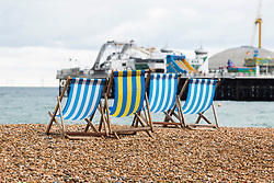 © Licensed to London News Pictures. 08/09/2016. Brighton, UK. Deckchairs stand unused on the beach in Brighton and Hove as dark clouds and wet weather is hitting the seaside resort. Photo credit: Hugo Michiels/LNP