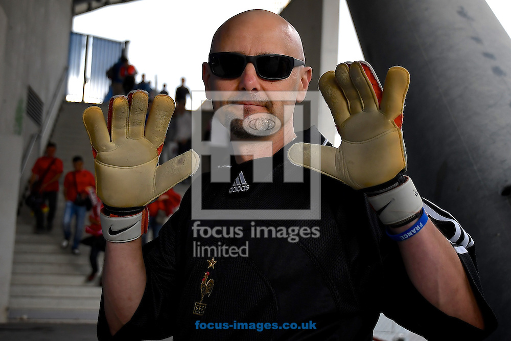 General view of the exterior of the stadium showing a fan who has dressed up as former France and Marseille goalkeeper Fabian Barthez pictured ahead of the UEFA Euro 2016 match at Stade Velodrome, Marseille<br /> Picture by Kristian Kane/Focus Images Ltd 07814482222<br /> 15/06/2016