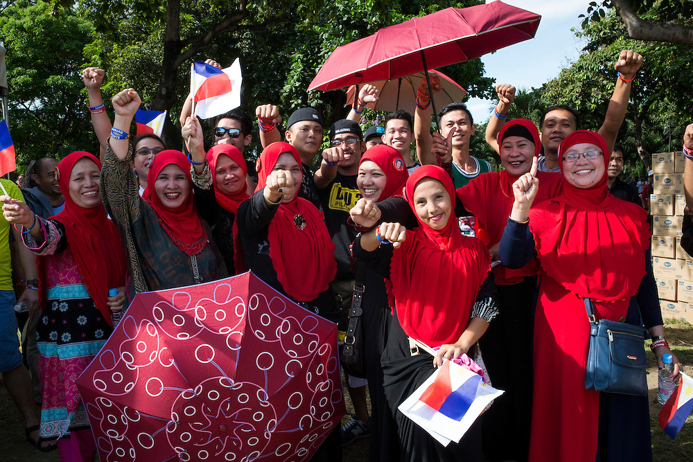 MANILA, PHILIPPINES - MAY 7: Muslim supporters wearing red vail to show support to Mayor Rodrigo &quot;Digong&quot; Duterte his party PDP-Laban in meeting de advance in Luneta Grand Stand, Manila, Philippines on Saturday, May 7, 2016. The Philippine national election will be held on May 9, 2016.<br /> <br /> Photo by Richard A. de Guzman