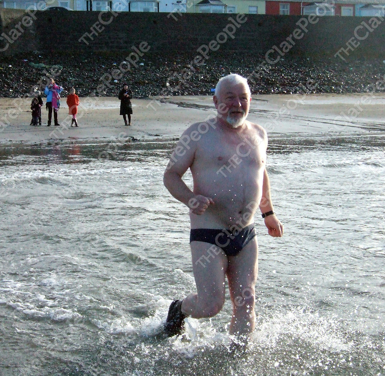 Founder member of Kilkee Sub Aqua Club Noel Gleeson enters the water at Kilkee Beach during the club's annual Christmas Day swim