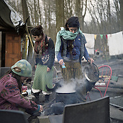 "Cooking is a communal activity, especially when the weather is nice. Diggers will often take turns cooking a large, shared meal with whatever has been recently liberated (""skipped"") from local supermarket dumpsters."