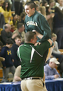 John A. Coleman's Benjamin Mesuda celebrates with assistant coach Jeff Tomaseski after their team defeated Chapel Field in the Section 9 Class D boys' basketball championship game at Mount Saint Mary College in Newburgh on March 5, 2010.