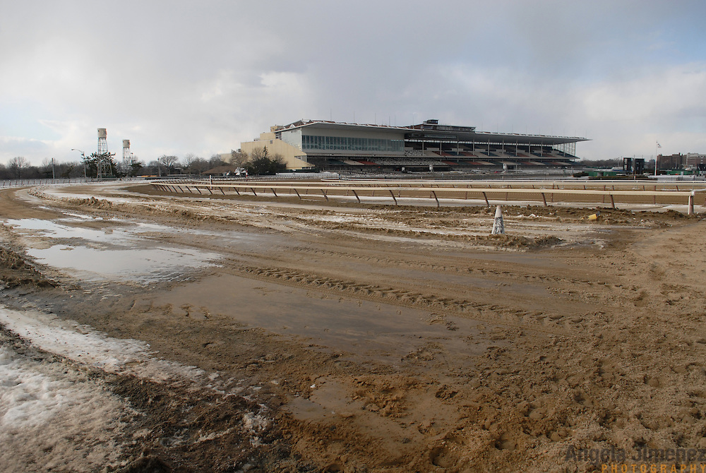 The Aqueduct racetrack building in New York City is seen from the outer dirt track, which is unused in the winter season, on February 18, 2007. ..Betting on the horses is still a popular game and the money still flows, but off track betting and other forms of entertainment have eroded live attendance at the races.  The daily diehard betters and horse lovers who sparsely populate the place on work days are joined by a bigger crowd on the weekends. ..The Aqueduct, located in Ozone Park, Queens, is the only horse racing track in New York City and probably the coldest in the country (most of the others are in Kentucky, Florida or California). Horses race on the winterized inner dirt rack from January 1st through the end of April. Aqueduct was built in 1894, renovated in 1959, then opened for winter racing in 1975. It is the winter race track operated by the New York Racing Association (NYRA), which also runs Belmont and Saratoga in the warm seasons. Betters at Aqueduct watch and bet on the nine daily live races and all other races around the country via Simulcast. ..