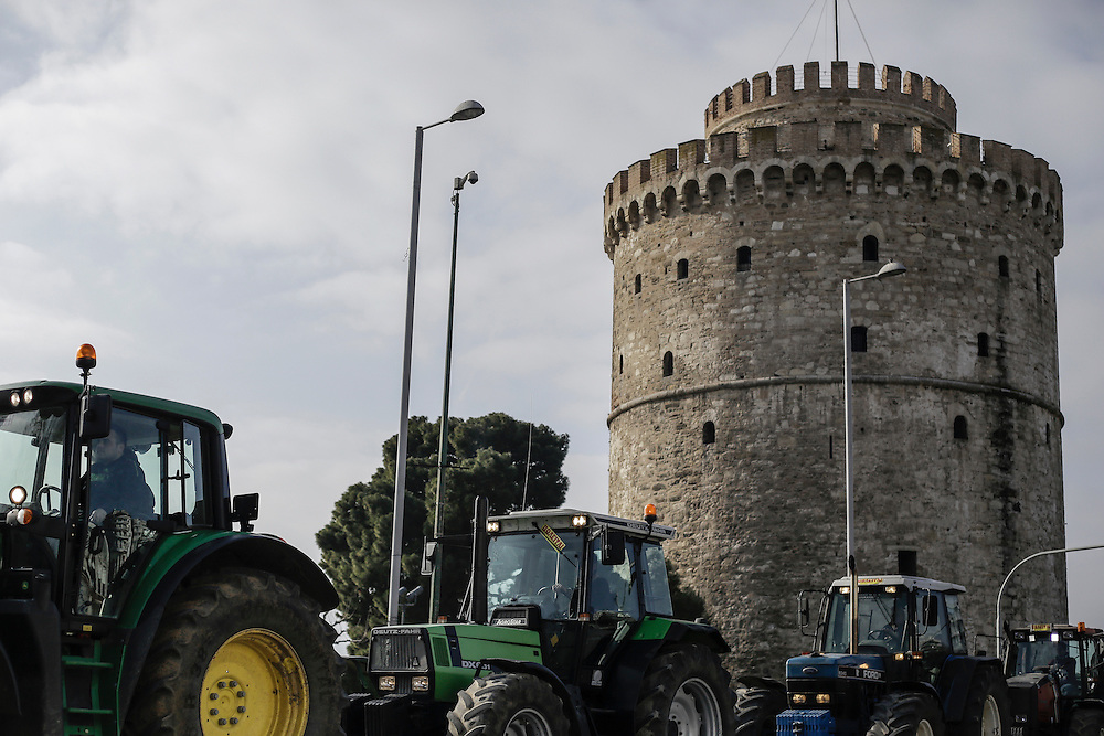 Farmers with their tractors in front of the white tower during a march inside the city of Thessaloniki, Greece, on the 2nd of February 2017. Farmers from around northern Greece gathered in Thessaloniki during the opening of the Zootechnia international livestock to demonstrate against the austerity measures put by the Greek government.