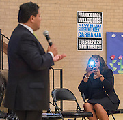 Houston ISD Trustee Rhonda Skillern-Jones captures comments by Superintendent Richard Carranza during a stop of the Listen & Learn tour at Black Middle School, September 20, 2016.
