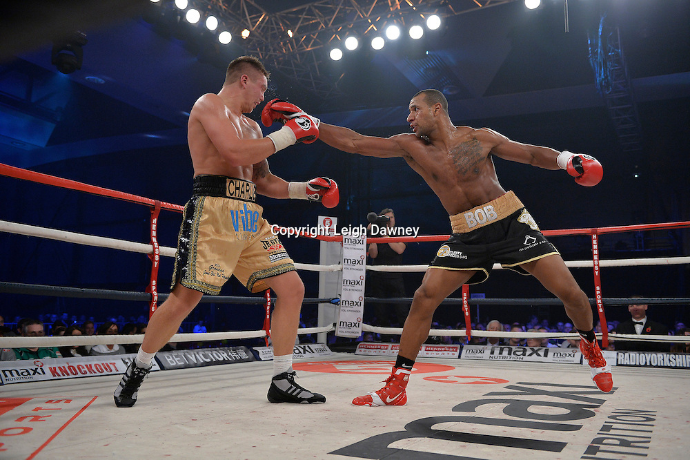 Bob Ajisafe (black shorts) defeats Matty Clarkson for the Maxi Nutrition Knockout at Glow, Bluewater, Kent on the 8th November 2014. Promoter: Hennessy Sports. © Leigh Dawney Photography 2014.