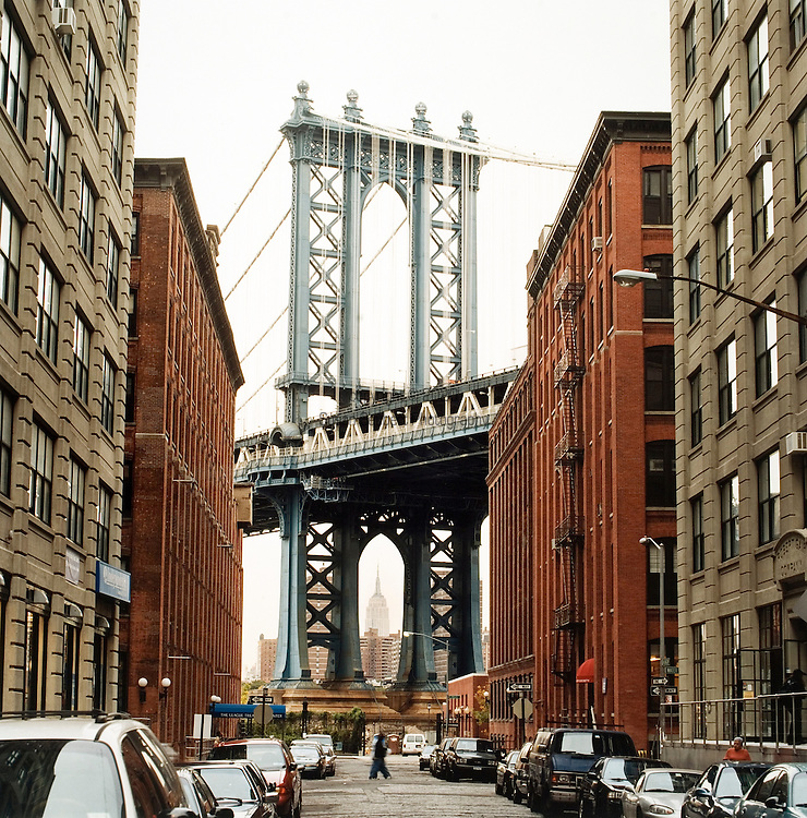 Framing Midtown Manhattan's Empire State Building is the Manhattan Bridge, from the view of DUMBO in Brooklyn, New York