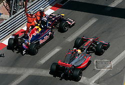 MONTE-CARLO, MONACO - Sunday, May 24, 2009: Sebastian Vettel (GER Red Bull) crashes out as Lewis Hamilton (GBR McLaren) passes during the Monaco Formula One Grand Prix at the Monte-Carlo Circuit. (Pic by Juergen Tap/Hoch Zwei/Propaganda)