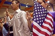 "04 JULY 2009 -- PHOENIX, AZ: Airman VINCENT TSANG takes the oath of citizenship and becomes a US citizen during a naturalization ceremony in Phoenix, AZ, July 4. Tsang is currently an enlisted man in the US Air Force. U.S. Citizenship and Immigration Services and South Mountain Community College in Phoenix, AZ, hosted the 21st annual ""Fiesta of Independence"" Saturday, July 4. More than 180 people from 58 countries took the US Oath of Citizenship and became naturalized US citizens. The ceremony was one of dozens of similar ceremonies held across the US this week. USCIS said more than 6,000 people were naturalized US citizens during the week.  Photo by Jack Kurtz / ZUMA Press"