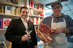 "Tom Mylan holds a highly coveted slab of meat as James Moreland saultes with a Bombay Sapphire Martini.  Tom Mylan and James Moreland collaberate on a dinner party entitled ""Gin and Meat"" at The Brooklyn Labs, in Williamsburg, Brooklyn, NY.  All drinks made with Bombay Sapphire Gin by James Moreland, and all meat butchered and prepares by Tom Mylan.  Photograph by © Jackie Neale Chadwick"