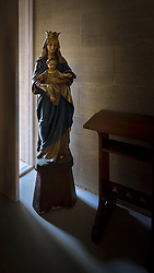 As I was preparing to lock up and leave the Ripon College Chapel, this madonna statue caught my eye, standing in the late evening light from a window. With the interior lights turned off the extreme backlighting made a beautiful play, but was quite difficult to capture.<br />