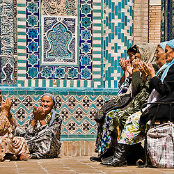 Group of muslim women praying in the Shahr-i-Zindah mausoleum, Samarcand, Uzbekistan
