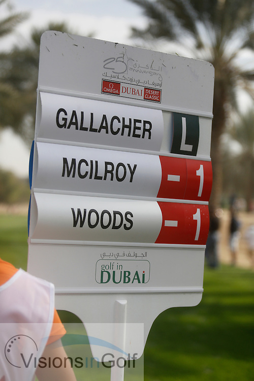Rory McIlroy and Tiger Woods scoreboard<br /> Omega Dubai Desert Classic, Emirates GC, UAE, January 2014<br /> Picture Credit:  Mark Newcombe / www.visionsingolf.com