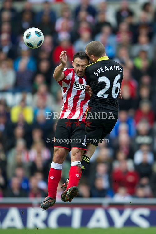 SUNDERLAND, ENGLAND - Sunday, March 20, 2011: Liverpool's Jay Spearing and Sunderland's Steed Malbranque during the Premiership match at the Stadium of Light. (Photo by David Rawcliffe/Propaganda)