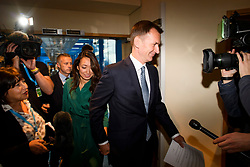 © Licensed to London News Pictures. 30/09/2018. Birmingham, UK. British Foreign Secretary JEREMY HUNT being questioned by media as he arrives with his wife LUCIA HUNT at the conference centre for day one of the 2018 Conservative Party autumn conference at the ICC in Birmingham. This years event will focus heavily on negotiations with the Eu over the UK's exit form the EU. Photo credit: Ben Cawthra/LNP