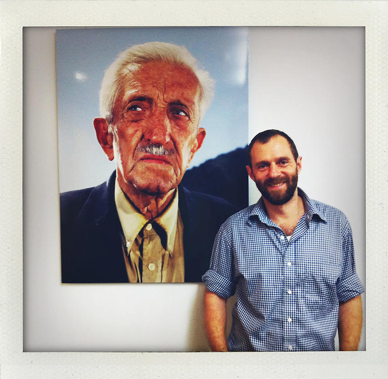 "Photographer Dirk Anschuetz with one of his images from the series ""The Sultans""..photo shot with iPhone 4 in  New York City ..Photo © Stefan Falke (developed with app: shakeitphoto)."